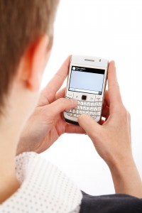 A man messaging on a Blackberry