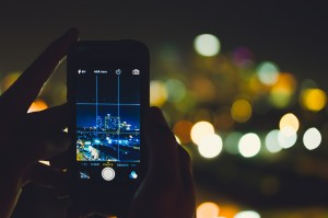 Picture of a city skyline being taken with a smartphone